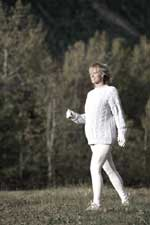 pregnant woman walking in stretch pants and sweater