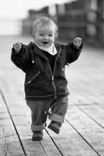Baby in Jacket Running Outside