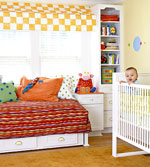 baby boy smiling in crib in Ultimate Nursery
