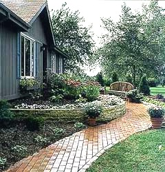 exterior photo of blue home with stone paved walk
