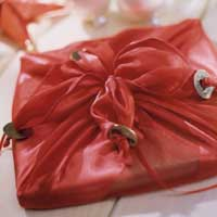 gift wrapped with red fabric and coins