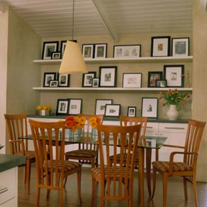 DiningRoomsAdditional_Room with wooden chairs and wall of pictures on shelves