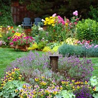 twocolor_Yellow and Purple Flower Assortment With Green Lawn Chairs and Pillar