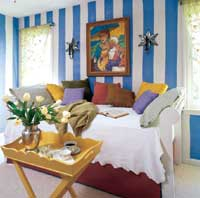 guest bedroom with blue and white striped wall - after