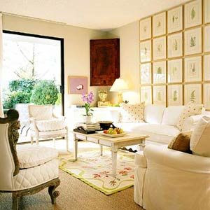 CottStyleSp05_White Sofas and Armchairs In Cream Living Room With Mosaic Picture Collage On Wall