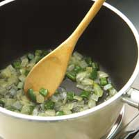 cooking vegetables with butter in saucepan
