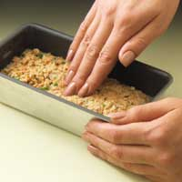 patting the fish mixture into greased loaf pan