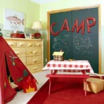 KidsRoomsSum05_McCaugheyCampRoom_Chalkboard closets red tent table