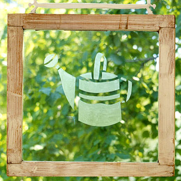 etched watering can on window hanging