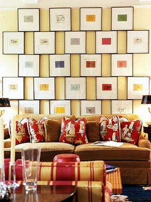 Staggered Collage Behind Brown Sofa