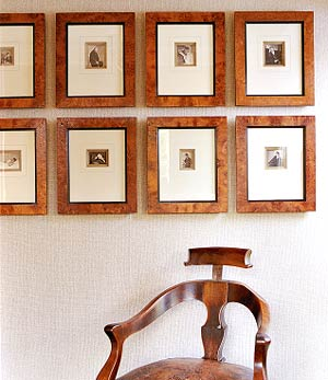 Wall of pictures over chair