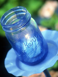 Close-up of blue glass votive