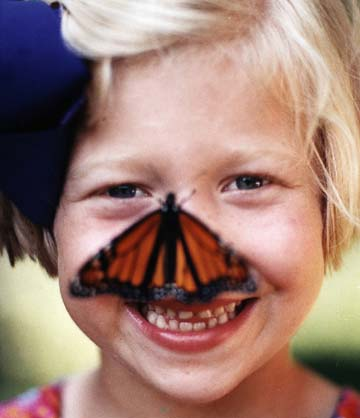 Girl with butterfly on her nose