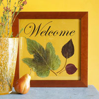 Welcome frame with dried leaves