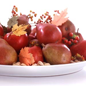Red pears and  nuts on tray