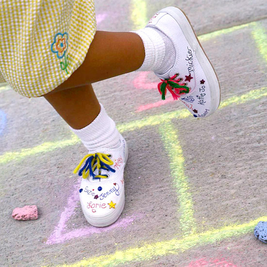 girl playing hop-scotch in autograph shoes