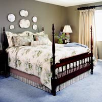 COL SOL 2002 Tan Bedroom With Decorative Plates Over Bed