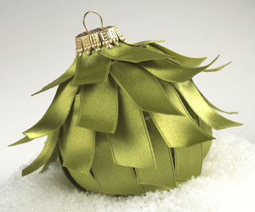 Green ball Christmas ornament covered with satin strips