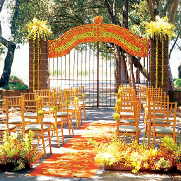 An orangeandgreen palette sets a dramatic tone for this outdoor wedding