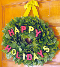 Closeup of Happy Holidays Pine Wreath