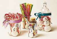 glass jars with clay snowmen
