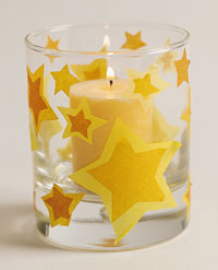 candle with tissue paper stars