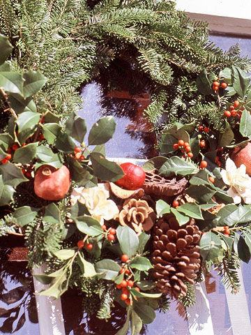 Detail of evergreen wreath with embellishments
