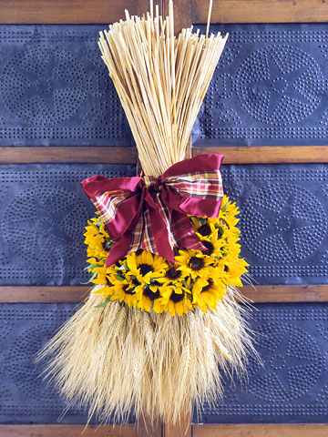 Wheat bundle with sunflowers and bow