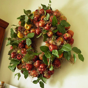 Wide Apple Wreath With Greenery On Yellow Wall