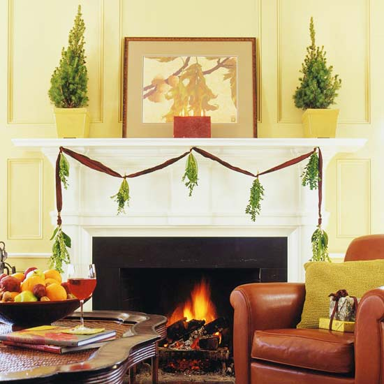 fireplace with dangling tree trim and ribbon