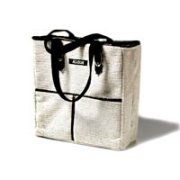 white and black hand bag with black straps
