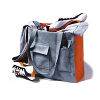 gray and orange bag with shoes and clothes