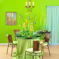 green dining room with topiaries