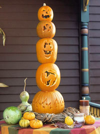 Stack of carved pumpkins on table