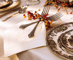 napkin and forks wrapped with autumn berry ring