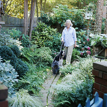 Homeowner with 2 dogs on brick path