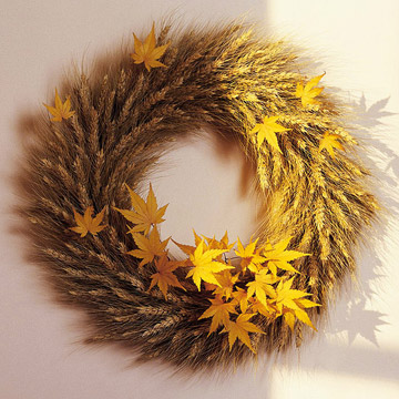 Wheat wreath with golden maple leaves