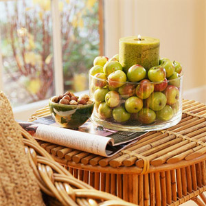 Green apples in dish with candle