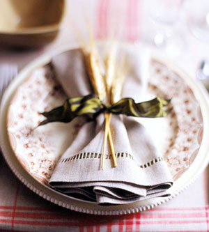 green ribbon tied on napkin with wheat