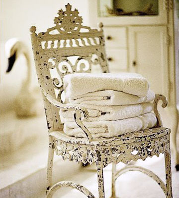 KBISep03_Four Towels Stacked On Cream Wrought Iron Chair