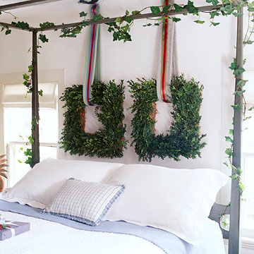 canopy bed with vines and hanging wreaths
