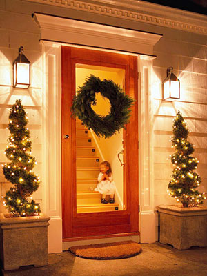 Front entrance with spiral christmas trees