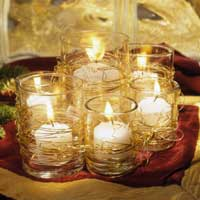 lit small candles in glass containers