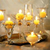 matching decorated glassware set with candles inside