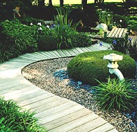 Wood deck path leads to garden retreat.