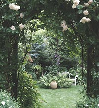 Shady arbor leads to a private garden.