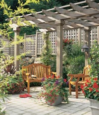 An arbor shades a wooden deck and  its benches.