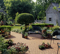 Brick patio with formal plantings