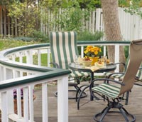 Wood deck with white curved railings