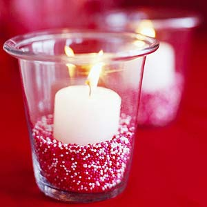 Candle in glass with  red white sand